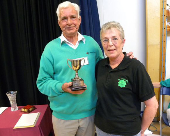 John Hare-Brown receives trophy from Margaret Kiff