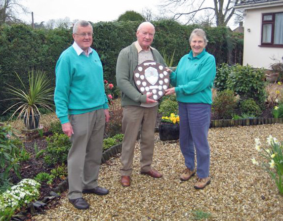 Richard Nunn, Chairman, Wimborne in Bloom, Brian Barraclough, with the winning trophy and Mary Allen
