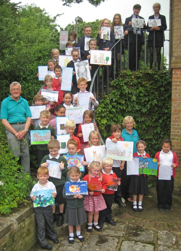 Wimborne in Bloom Art and Poetry Competition winners who were able to attend the photocall together with the Chairman of Wimborne in Bloom Richard Nunn