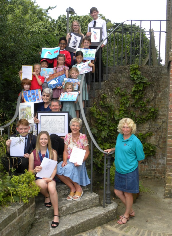 Photo of some of the Winners in both the Art and Poetry Competitions along with Susie Gatrell (front right) member of the Wimborne in Bloom Committee who co-ordinated the competition on behalf of the Committee