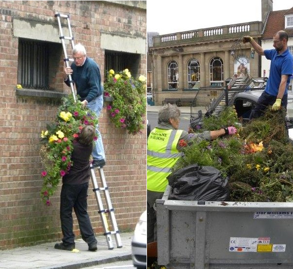 Taking down the hanging baskets